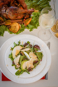 Garnished Citrus Glazed Roasted Turkey And Pea Salad On Holiday Table