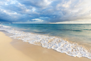 Gentle waves on a tropical beach at dawn