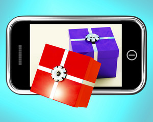 Gift Boxes Coming From Mobile Phone Shows Buying Presents Online