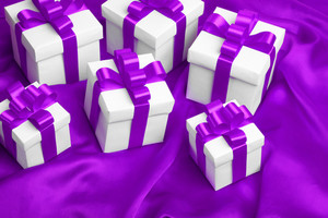 Gift on purple satin background