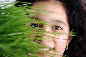Girl and grass, happy face behind green color