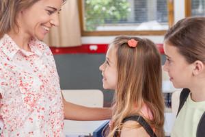 girl arriving at school
