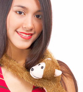Girl Being Hugged By A Toy Monkey
