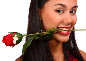 Girl Biting A Rose Given To Her By Her Boyfriend