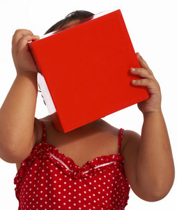 Girl Hiding Behind A Gift Box
