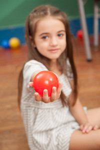 Girl holding a plastic ball