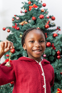Girl holding Christmas decoration