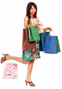 Girl Holding Lots Of Shopping