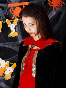 Girl In A Vampire Costume At Halloween