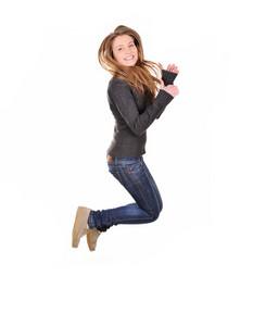 Girl jumping of joy over white background
