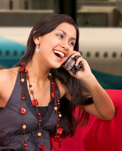 Girl On A Mobile Phone At The Airport