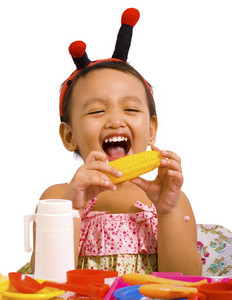 Girl Playing With Toy Food