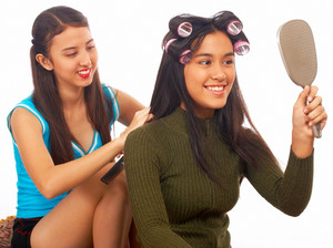 Girl Putting Her Hair In Rollers