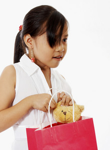 Girl Receiving A Birthday Gift