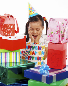 Girl Receiving Many Birthday Gifts