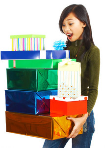 Girl Receiving Stack Of Gifts