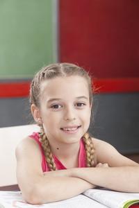 Girl smiling and looking at camera
