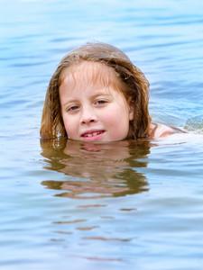 Girl Swiming In The Sea