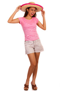 Girl Wearing Fashionable Shorts And Pink T-shirt