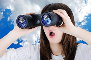 Girl with binoculars looking at Earth