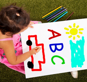Girl Writing Abc Shows Kid Learning Alphabet