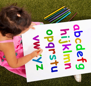Girl Writing Alphabet Shows Kid Learning