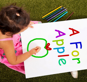 Girl Writing Apple Shows Kid Learning Alphabet