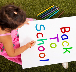 Girl Writing Back To School As Symbol For Education