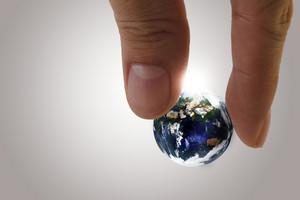 Globe In Fingers