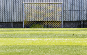 Goal soccer green field background