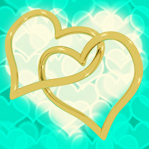 Gold Heart Shaped Rings On Turquoise Bokeh Representing Love And Romance