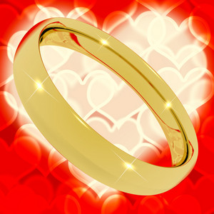 Gold Ring On Heart Bokeh Background Representing Love Valentine And Marriage