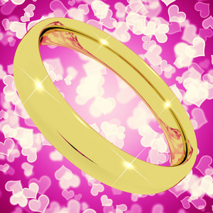 Gold Ring On Pink Heart Bokeh Background Representing Love Valentine And Marriage