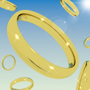 Gold Rings Falling From The Sky Representing Love Engagement Or Marriage