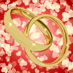 Gold Rings On Heart Bokeh Background Representing Love Valentine And Romance