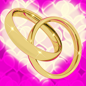 Gold Rings On Pink Heart Bokeh Background Representing Love Valentine And Romance