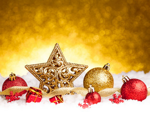 Golden christmas fir star decoration with gold and red ornaments