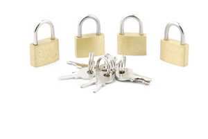 Golden Closed Padlocks With Keys On White