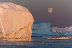 Golden iceberg against a full moon