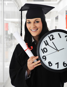Graduating girl with diploma holding a watch