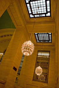 Grand Central Terminal interior shot of the hanging chandeliers and skylights.