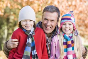 Grandfather and grandchildren on autumn walk