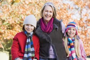 Grandmother and grandchildren on autumn walk