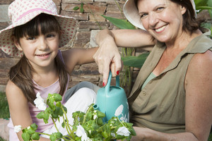 Grandmother and granddaughter in garden