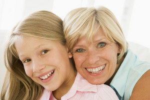 Grandmother and granddaughter smiling