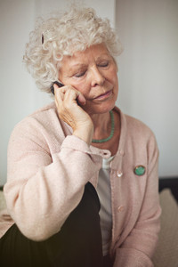 Grandmother using a cell phone in communicating