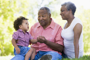 Grandparents with grandson in park