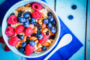 Granola With Berries And Almonds In A Bowl