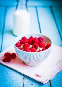 Granola With Raspberries In A Bowl On Wooden Background