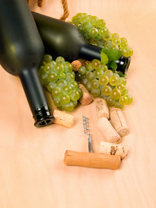 Grapes And Dull Wine Bottles